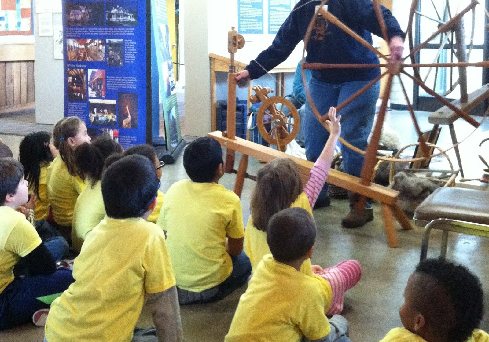 Mary Nichols showed the kids how she spins on a spinning wheel.