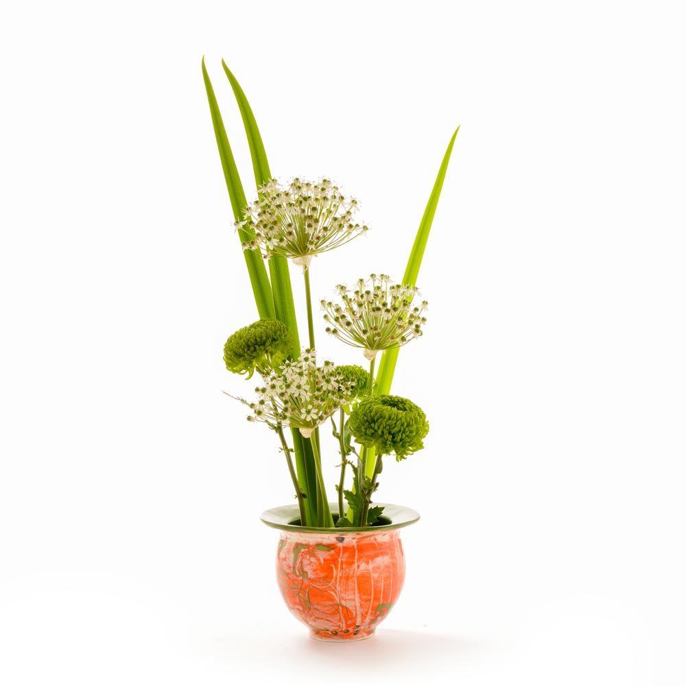 orange green and white wheel thrown small low vase