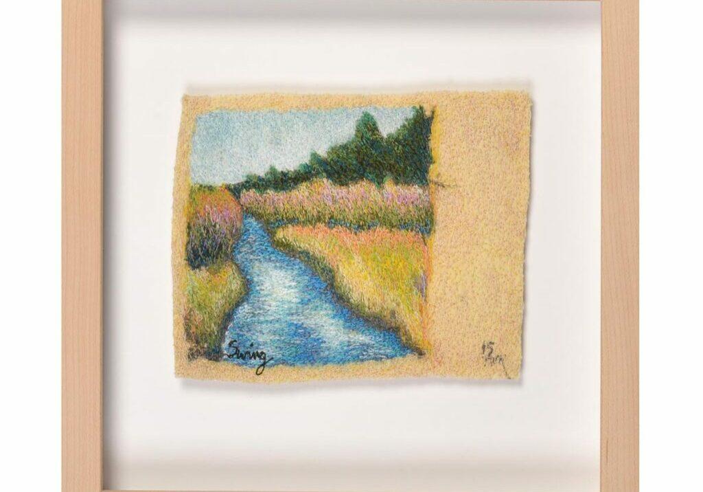 embroidered landscape image of stream, framed embroidery landscape