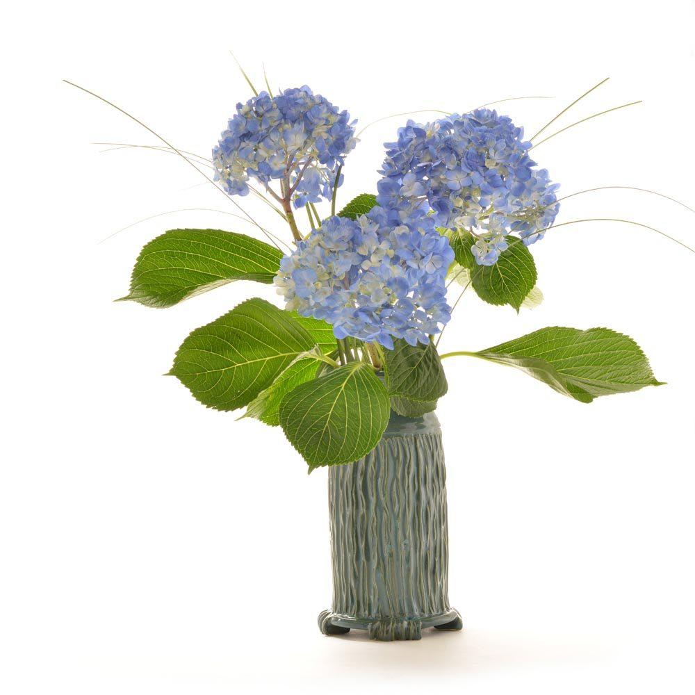 dark teal glaze with flowers