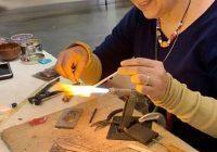 glass bead maker demonstration at the folk art center
